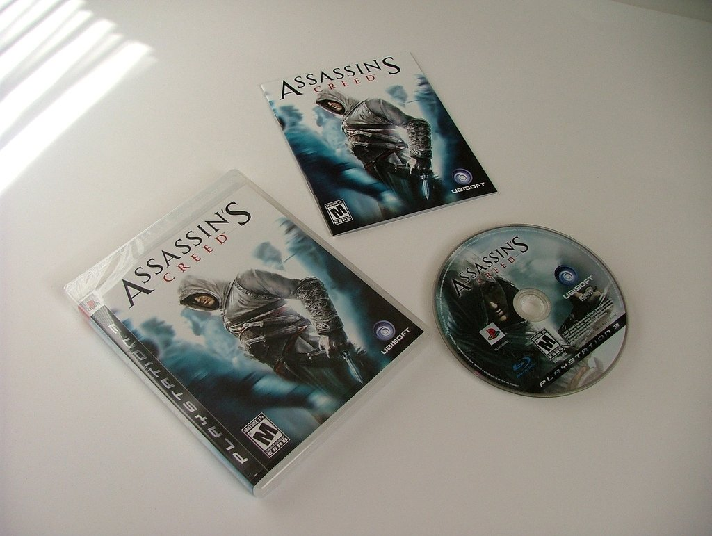 Assassin's Creed con su manual de usuario