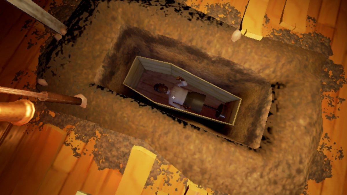 Maniquí enterrado en la tumba