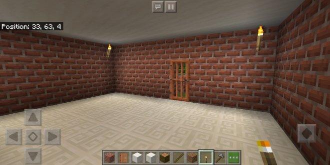 Uma casa de tijolo por dentro no Minecraft